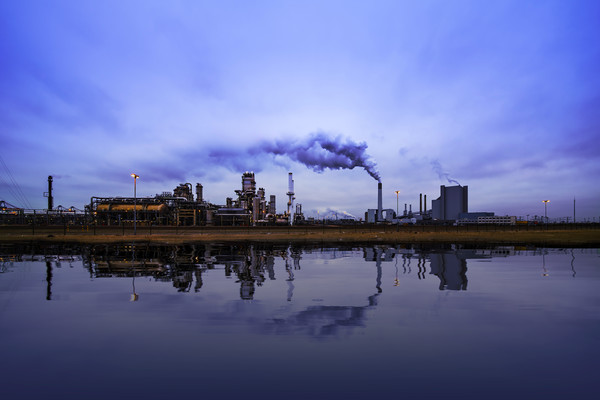 Reflection of refineries and its chimney  Canvas print by Charlie Brown
