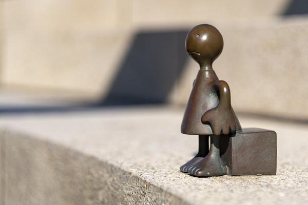 Sad traveler, sculptures of Tom Otterness  Canvas print by Charlie Brown