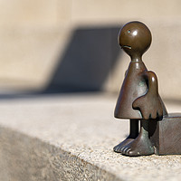 Buy canvas prints of Sad traveler, sculptures of Tom Otterness  by Charlie Brown