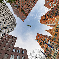 Buy canvas prints of A plane flying over the headquarters and modern br by Charlie Brown