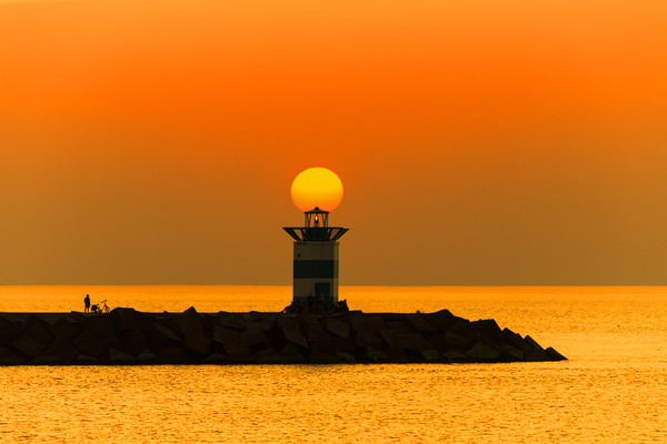 Sunset on the lighthouse Canvas print by Charlie Brown