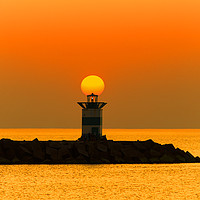 Buy canvas prints of Sunset on the lighthouse by Charlie Brown