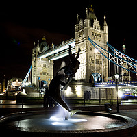 Buy canvas prints of Girl and Dolphin Statue London by David Pyatt