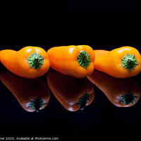 Buy canvas prints of Orange Bell Peppers and reflections by Dave Tyrer