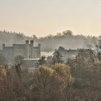 Buy canvas prints of Through The Mist Leeds Castle by Dave Godden