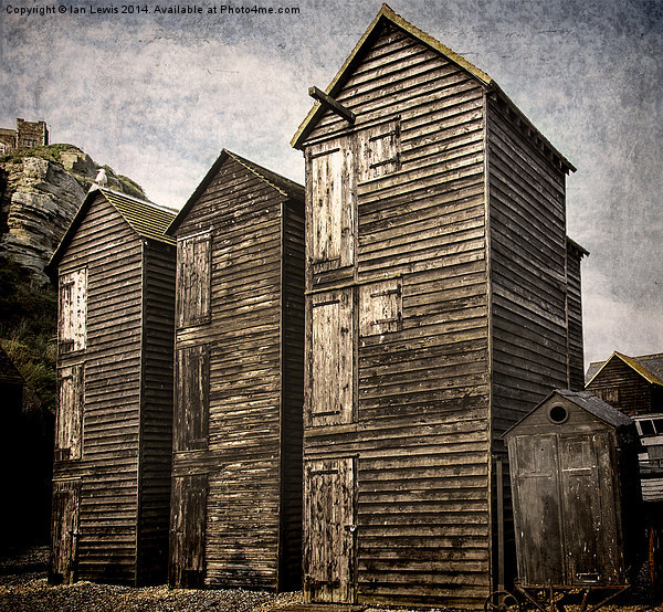 Fishermens Huts at Hastings Print by Ian Lewis