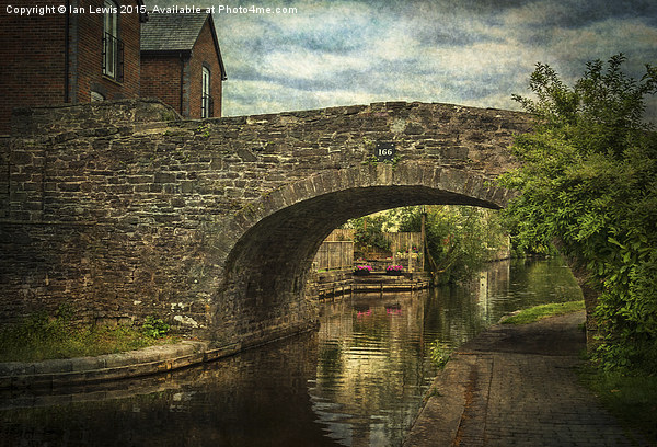 Canal Bridge In Brecon Canvas print by Ian Lewis