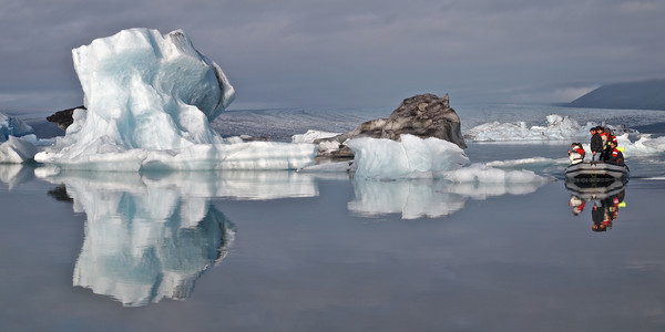 Iceberg reflection with RIB boat Canvas print by mark humpage