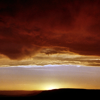 Buy canvas prints of Underneath Stormclouds: Sunset at Fish River Canyo by Carole-Anne Fooks