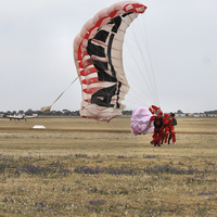 Buy canvas prints of  Army Red Beret Parachute Team Member Landing by Carole-Anne Fooks