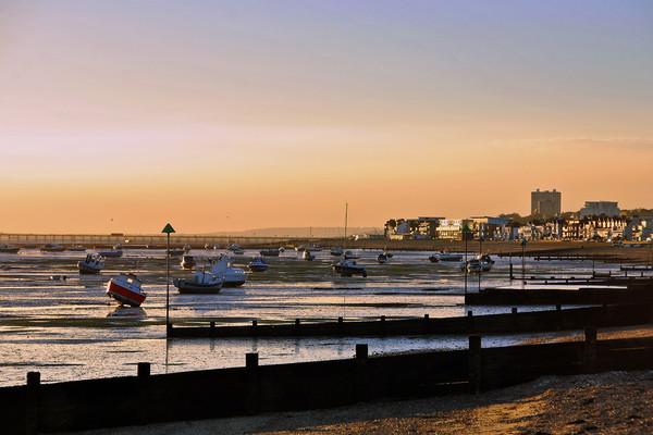 Sunset over Thorpe Bay beach near Southend on Sea  Canvas print by Andrew Evans