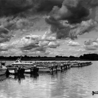 Buy canvas prints of Rutland Water Hire Boats by Adam Payne