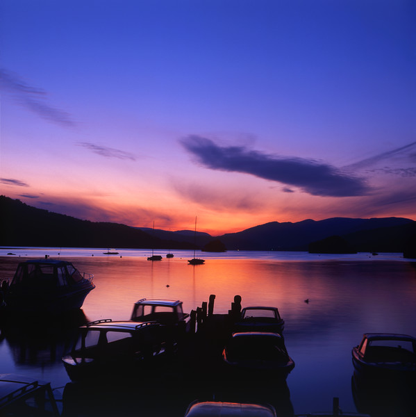 Boat Jetty  at sunset on  Windermere, Cumbria, UK Canvas print by Maggie Mccall