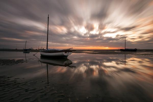 """Light Explosion on Meols Estuary"" Canvas print by raymond mcbride"