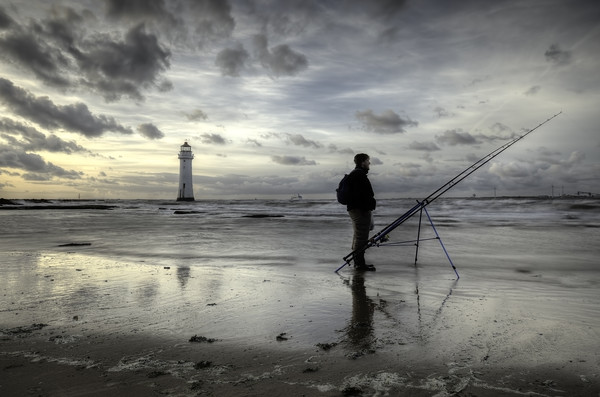Fisherman at Perch Rock Lighthouse Print by raymond mcbride