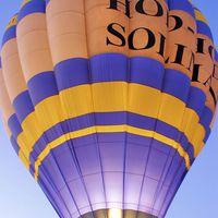 Buy canvas prints of Flaming Hot Air Balloon by Brian  Raggatt