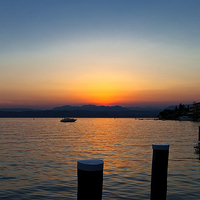 Buy canvas prints of Sunset on Lake Garda by Jim Jones