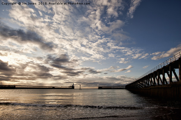 Early morning between the piers. Canvas print by Jim Jones