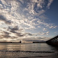 Buy canvas prints of Early morning between the piers. by Jim Jones