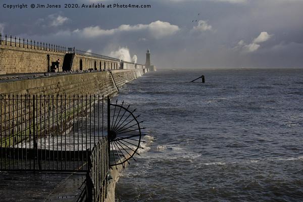 Waves splashing over Tynemouth Pier Canvas print by Jim Jones