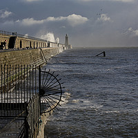 Buy canvas prints of Waves splashing over Tynemouth Pier by Jim Jones