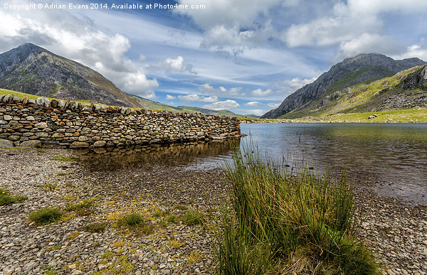 Lake Stone Wall Canvas print by Adrian Evans