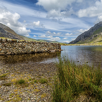 Buy canvas prints of Lake Stone Wall by Adrian Evans
