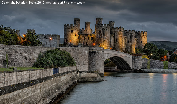 Conwy Castle by Lamplight Canvas print by Adrian Evans
