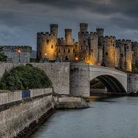 Buy canvas prints of Conwy Castle by Lamplight by Adrian Evans