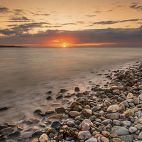 Buy canvas prints of Sunset Deganwy Beach by Adrian Evans