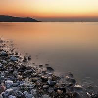 Buy canvas prints of Ocean Stones Deganwy Wales by Adrian Evans