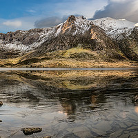 Buy canvas prints of Frozen Idwal Lake by Adrian Evans