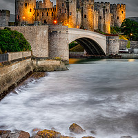 Buy canvas prints of Conwy Castle At Night by Adrian Evans