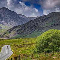 Buy canvas prints of Biker in Snowdonia Wales by Adrian Evans