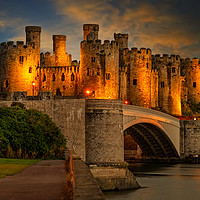 Buy canvas prints of Lights On Conwy Castle by Adrian Evans