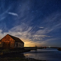 Buy canvas prints of  The old coal barn in Thornham under the star ligh by Gary Pearson