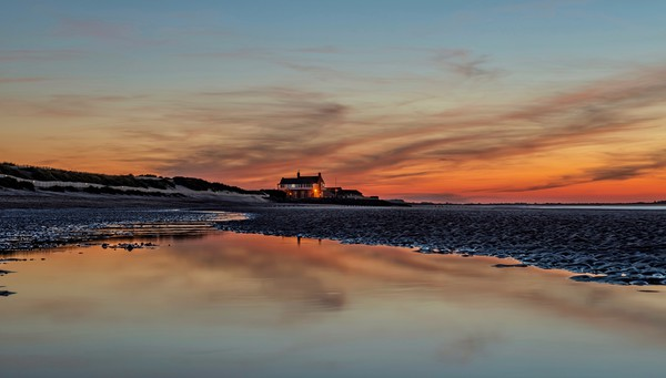 Sunset reflections on Brancaster beach Canvas print by Gary Pearson