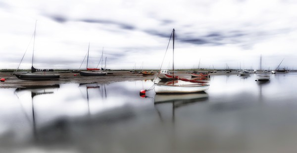 Low tide at Brancaster Staithe in Norfolk  Canvas print by Gary Pearson