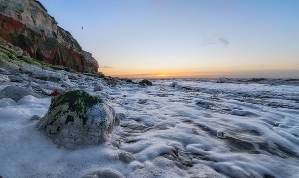 A subtle Winter sunset from Hunstanton beach  Canvas print by Gary Pearson