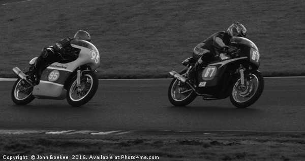 Racing bikes at Snetterton racetrack  Canvas print by John Boekee