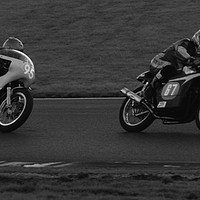 Buy canvas prints of Racing bikes at Snetterton racetrack  by John Boekee