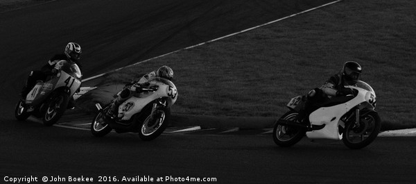Racing bikes at Snetterton racetrack  Canvas print by John Boekee