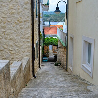 Buy canvas prints of Primosten Old town back street Croatia by Diana Mower