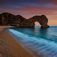 Buy canvas prints of Durdle Door Sunset Wave by Ashley Chaplin