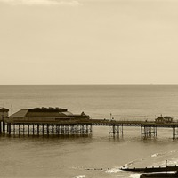Buy canvas prints of Cromer Pier by Rebecca Giles