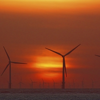 Buy canvas prints of Wind Farm at Sunset by John Wain