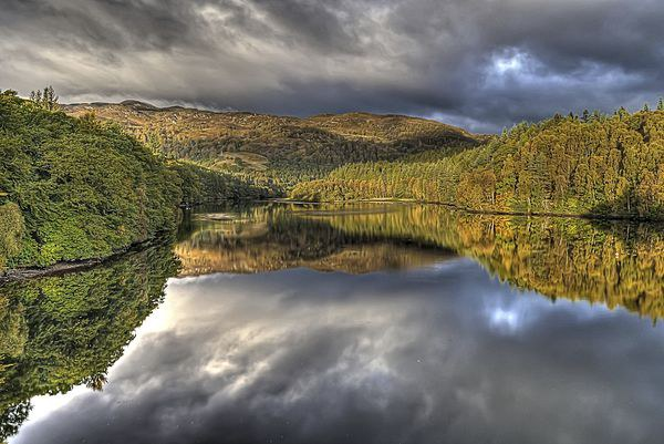 Loch  Faskally reflections Canvas print by jim sloan scotland canvas pri