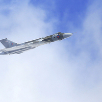 Buy canvas prints of  Avro Vulcan XH558 through the clouds by Debbie Metcalfe