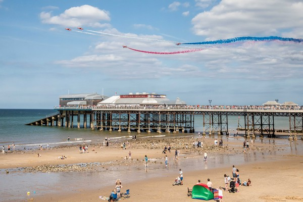 Red Arrows Flying Over Cromer Pier  Canvas print by David Woodcock