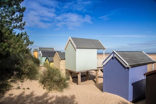 Wells Next The Sea, Colourful Beach Huts  Canvas print by David Woodcock